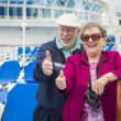 Senior Couple With Thumbs Up on Deck of Cruise Ship — Stock Photo #71537151