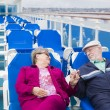 Senior Couple Relaxing On The Deck Of Cruise Ship — Stock Photo #71537175