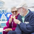 Senior Couple Enjoying Ice Cream On Deck Of Cruise Ship — Stock Photo #71537211