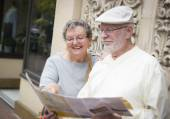 Tourist Senior Couple Looking at Brochure Map — Stock Photo