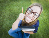 Wide Angle of Pretty Young Woman with Books and Pencil — Stock Photo
