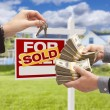 Handing Over Cash for Keys in Front of House, Sign — Stock Photo #77658574