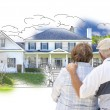 Embracing Senior Couple Over House Drawing and Photo on White — Stock Photo #77658618