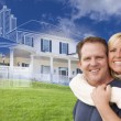 Hugging Couple with Ghosted House Drawing Behind — Stock Photo #78541042