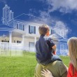 Young Family Facing Ghosted House Drawing Behind — Stock Photo #78541062