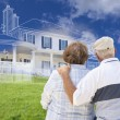 Senior Couple Faces Ghosted House Drawing, Green Grass Hill Behi — Stock Photo #78541358