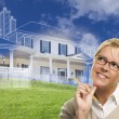 Smiling Woman Holding Pencil Looking to Ghosted House Drawing Be — Stock Photo #78541374