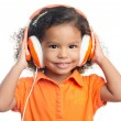 Small afro american girl with bright orange headphones — Stock Photo #53132655