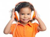 Small afro american girl with bright orange headphones — Stock Photo