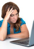 Stressed woman looking at her computer — Stock Photo