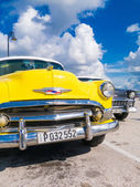 Colorful yellow vintage car in Havana — Stock Photo