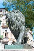 Bronze Lion at Paseo del Prado — Stok fotoğraf