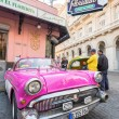 Vintage car next to restaurant — Stock Photo #62278329