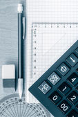 School supplies used in math toned in blue — Stock Photo