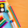 Colorful art supplies on a school desk — Stock Photo #64540017