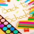 Art supplies framing the words BACK TO SCHOOL — Stock Photo #64547181