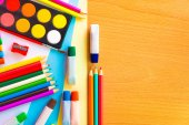 Colorful art supplies on a school desk — Stock Photo