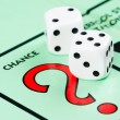 Dice next to the CHANCE space in a Monopoly game — Stock Photo #65379417