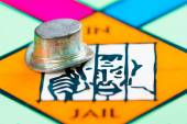 Hat token next to the JAIL in a Monopoly game — Stock Photo