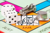 Dice and token next to the JAIL in a Monopoly game — Stock Photo