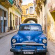 Old car on  shabby street — Stok fotoğraf #69022033