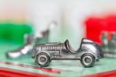 Car token on monopoly game board — Stock Photo