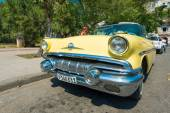 Yellow vintage american car — Stock Photo