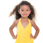 Small hispanic girl wearing a yellow summer dress — Stock Photo
