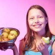 Teen girl holding a colander full of apples — Stock Photo #52628737