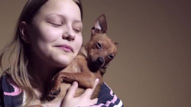 Teen girl with a little doggy. Playing and teasing. — Stock Video