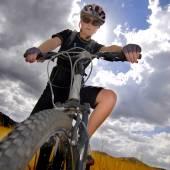 Young Woman Mountain Biking — Stock Photo