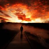 Sunrise Yellowstone Geysers with Man Silhouetted — Stock Photo