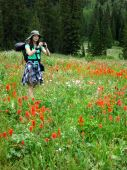 Woman Girl Backpacking with Wildflowers Taking Photograph — Stock Photo