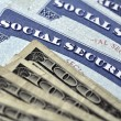 Social Security Cards and Cash Money — Stock Photo #52745925