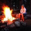 Girl Alone by Campfire While Camping — Stock Photo #53118637