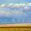 Windmills in Rows with Mountains Clouds and Fields — Stock Photo #58295567