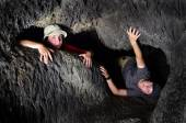 Two Kids Exploring Cave — Stock Photo