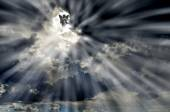Angel in Sky Clouds with Rays of Light — Stock Photo