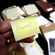 Messy Office with Get Organized Note — Stock Photo #62807257