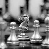 Chess Board with Knight Facing Opponent — Stock Photo