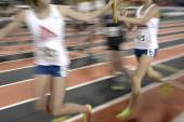 Running a Relay Race on Tract Handing Off Baton — Stock Photo