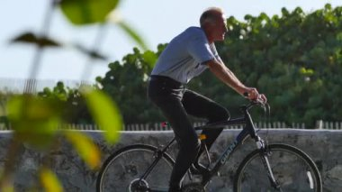 Senior riding a bike 4k — Stock Video