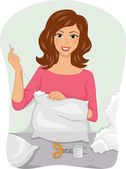 Woman Mending Her Pillow — Stock Photo
