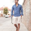 Young casual man walking and looks to side — Stock Photo #52425095