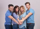 Group of people holding hands together as a team — Stock Photo