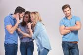 Group of people making fun and gossip about their friend — Stock Photo