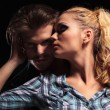 Blonde woman looking away and embracing her boyfriend — Stock Photo #53014573