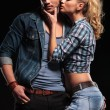 Blonde woman trying to kiss her boyfriend on the cheek — Stock Photo #53014643
