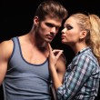 Blonde woman pulling her boyfriends chin with her finger — Stock Photo #53014711