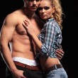 Sexy blonde woman leaning on her topless boyfriend — Stock Photo #53014715